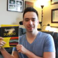 Matthew holding the book to help teach you the language of spanish